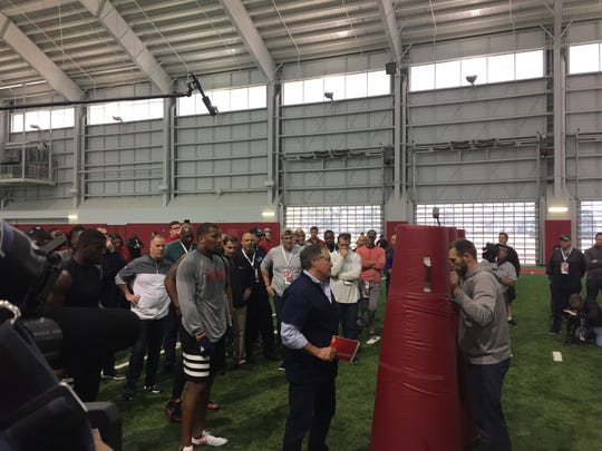 Patriots coach Bill Belichick guides NC State defensive end Bradley Chubb through a drill Monday at the Wolfpack's Pro Day.
