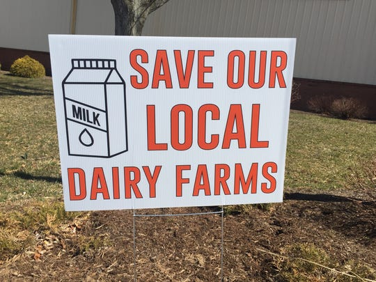 Supporters of Lebanon County dairy farms passed out signs Monday during a rally at the Lebanon Valley Expo Center.