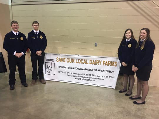 From left to right, Northern Lebanon students Devin Hostetter and Cameron Seiger and Annville-Cleona High School students Sarah Erickson and Kali Schwenk, all members of Future Farmers of America, attended a rally Monday in support of local dairy farmers.