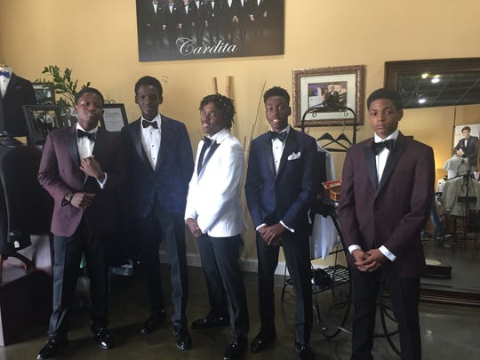 Members of the Boys & Girls Clubs of St. Lucie County's Infinity Teen Club and Garden Terrace Teen Clubwere fitted with tuxedos during a field trip to Cardita's Formal Wear in Jensen Beach.