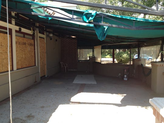 A 2015 photo of the former Marie Callender's restaurant in Simi Valley shows items left by people who had been using the patio as a place to sleep.