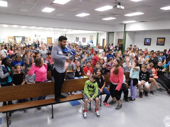 Students were on their feet for an exciting violin solo.