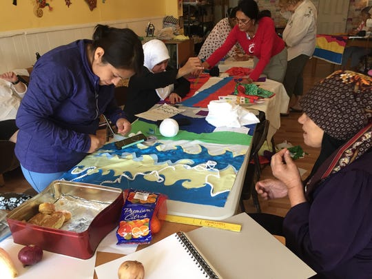 Refugee and immigrant women make quilts at The Welcome Project in Camp Washington, an outreach of an art gallery called Wave Pool.