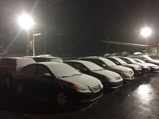 Snow begins to stick to cars at a Town of Poughkeepsie