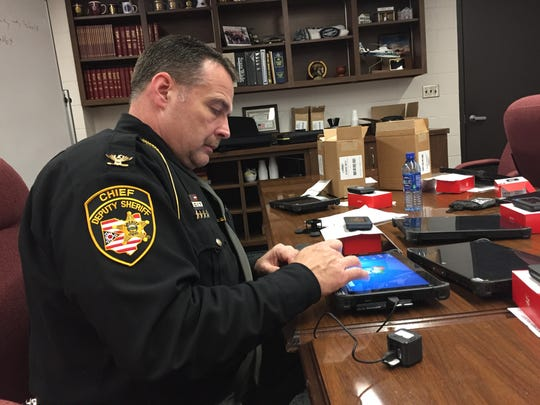 Sandusky County Chief Deputy Ed Hastings demonstrates how body camera footage can be uploaded by deputies from their cruisers.