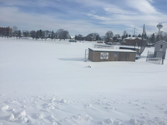 The Cedar Crest baseball field, like the rest of the area's athletic fields, was snow-covered Thursday morning following a two-day storm that continued the rough weather for local spring sports teams.