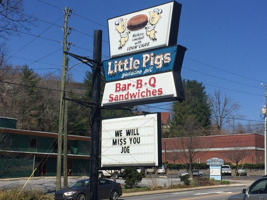 "A sign outside of Little Pigs BBQ  Friday reads, ""We will miss you Joe."""