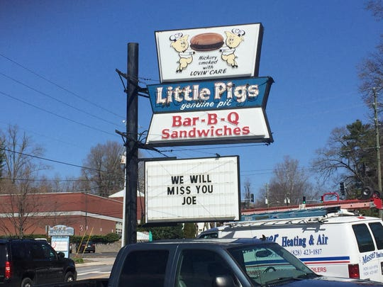 """A sign outside of Little Pigs BBQ  Friday reads, """"We will miss you Joe."""""""