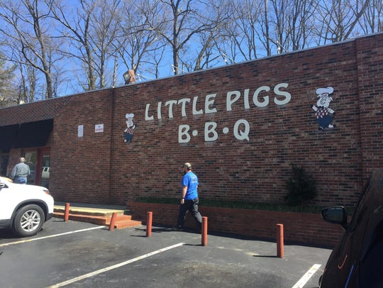 Customers enter Little Pigs BBQ for lunch on Friday.