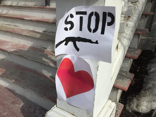 """Images of a rifle with the word """"STOP"""" had been taped up around downtown Montpelier on Saturday, March 24, in advance of the March for Our Lives at the Statehouse. Police say a similar image was spray-painted on the walkway to the Statehouse."""