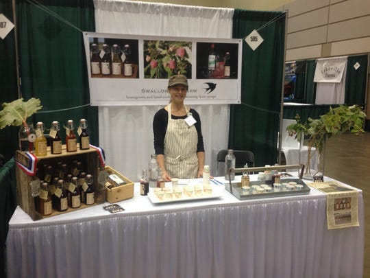 Anne Rausher of Swallowtail Farms in Mason, sampling the farm's products at the Making it In Michigan show.