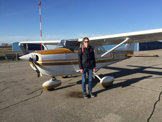 Ian Wolfe,stands beside the Cessna 172 he performed