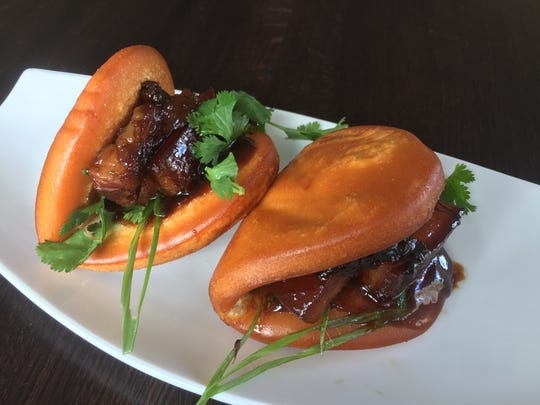 Sliders at the new Kwok's Bistro feature fried lotus leaf buns stuffed wtih braised hoisin pork belly.