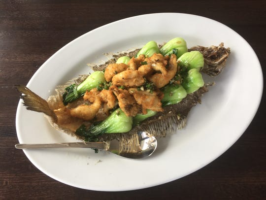 Fried sole chunks are decoratively presented on the