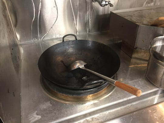A wok is ready for stir-fries in the almost entirely