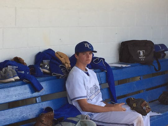 Barron Collier pitcher Henry Schave sits in the dugout