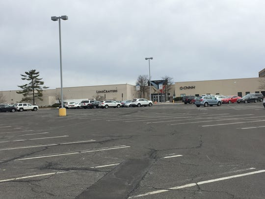 A parking lot is largely deserted outside the former