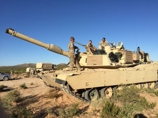A tank crew from Charlie Company, 1st Battalion, 6th