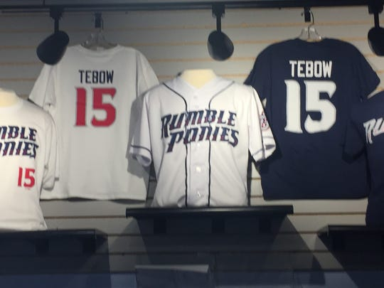 Tim Tebow apparel is displayed prominently in the Rumble Ponies store Wednesday at NYSEG Stadium.