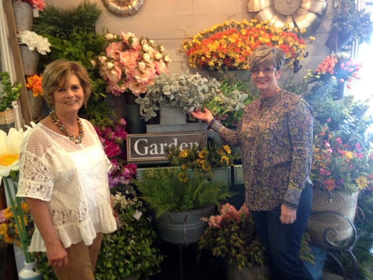 Brenda Boles, left, and manager Kimberly Redding explore the many floral opportunities at Real Deals.