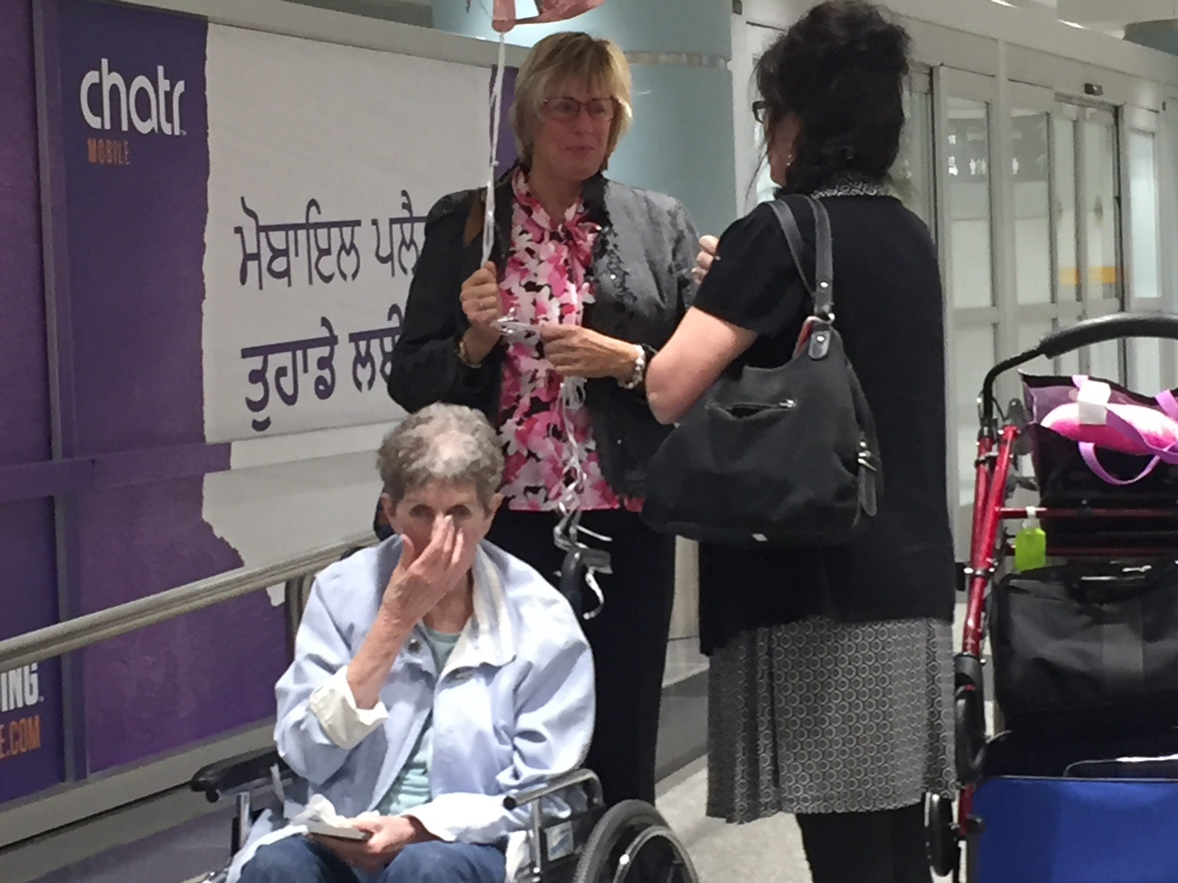 Kathy Kirkland (top left) and her birth mother, Joan Harrison (seated) met in person for the first time in late 2017 at the Toronto Airport.