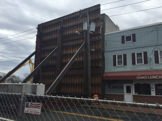 3-story structure now blocking front of condemned downtown