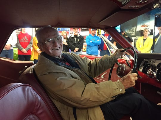 Harry Donovan smiles from behind the wheel of his restored 1967 Mustang at The Finer Details shop in Danville.