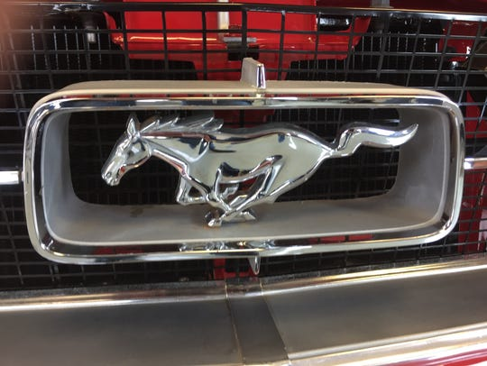 A chrome Mustang emblem on Harry Donovan's restored