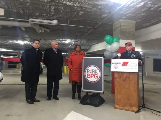 The Buccini/Pollin Group celebrates the opening of its parking garage at 8th and Orange Streets in WIlmington. Pictured: Chris Buccini, Mayor Mike Purzycki, City Council President Hanifa Shabazz and Mike Hare, senior vice president of development for BPG and Purzycki's former campaign manager.