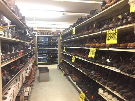 Among the many aisles of Paul's Discount, work boots