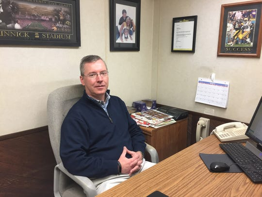 Rob Cassidy sits in the back office of the Paul's Iowa