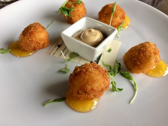 Lucilla is offering surf-and-turf Mother's Day dinners to go. Shown here are their pimento cheese fritters with a bourbon peach glaze.