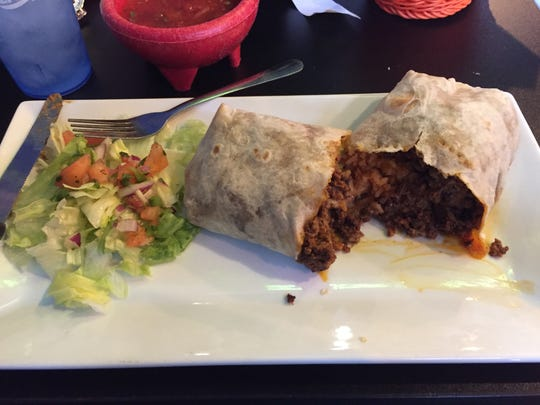 The super burrito ($9) at El Fogon in West Des Moines combines ground beef and chorizo with rice, beans, cheese and spicy salsa, with lettuce and pico de gallo on the side.