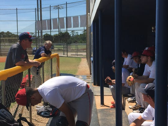 Estero baseball coach Gary White talks to his team