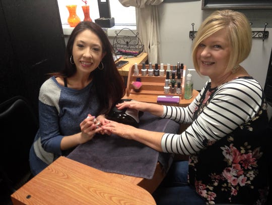 Niche nail technician Christine Krauss, left, consults