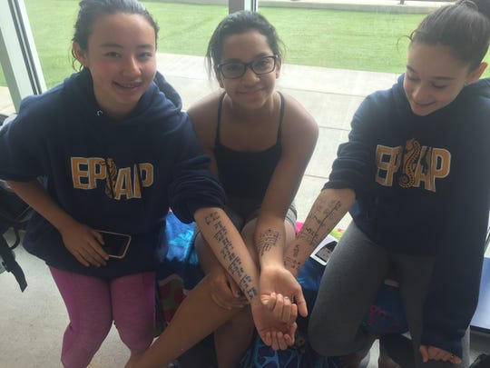 From left, Hannah Ramos, Viva Marrero and Kiera Gutierrez get ready to compete Saturday at the newly opened West Side competitive pool.