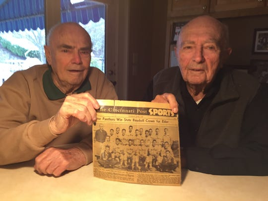 George Ranz (left) and Norb Ranz hold a photo of their
