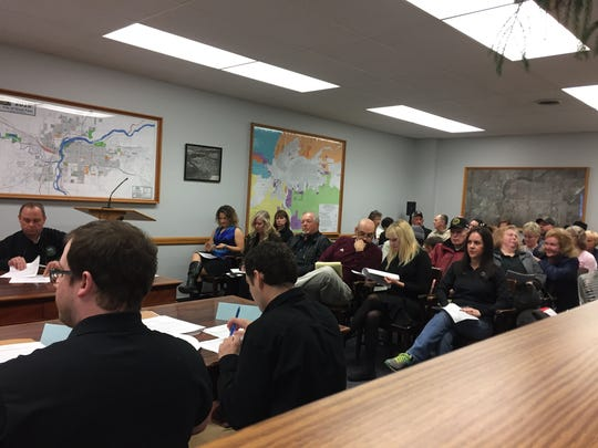 A full house waits to hear the Cascade County's decision