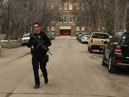 A Great Falls Police Department officer patrols near