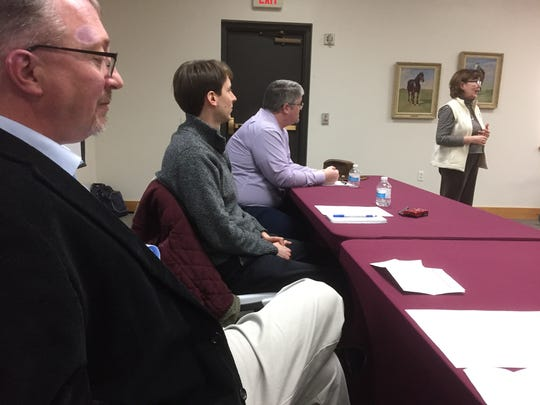 """From left, Andy Grove, Andy Hallman, Matt Milner and Rebecca Johnson participate in an """"information literacy"""" panel on Monday, April 9, 2018, at the public library in Fairfield, Iowa."""