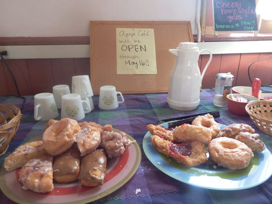 Baked goods sit on a table inside Agape Cafe in Iowa