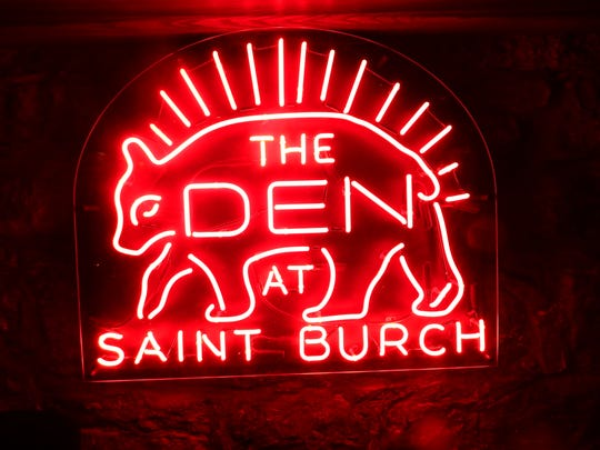 A custom-made red neon sign for St. Burch Tavern's namesake, Burch the former Hawkeye football mascot, is shown on April 11, 2018.