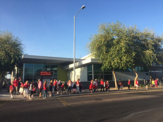 Parents, students and teachers at Madison Traditional Academy in Phoenix participate in the #RedForEd walk-in on April 11, 2018.