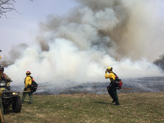 A column of smoke rises 3,000 feet from a field being burned to reduce the chance of wildfire at Beaver Brook Wildlife Management Area in White Township, Warren County.