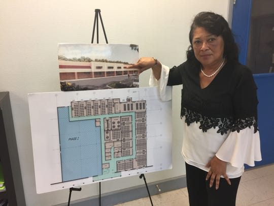Charlene Montford, principal of Legacy Academy Charter School, shows the school's plans to move to its current location in this file photo.