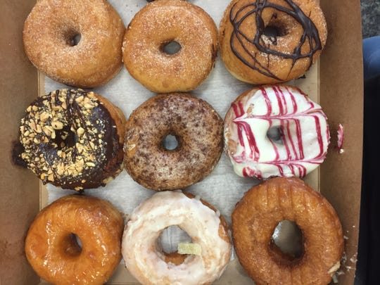 A selection of doughnuts from Vorrtex Doughnuts, including
