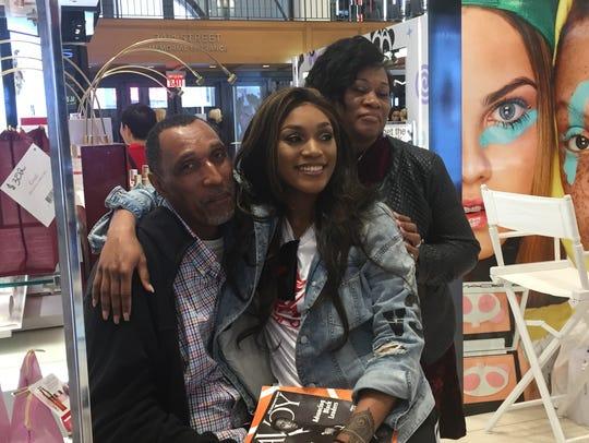 Victoria Vivians with her parents inside Macy's MAC