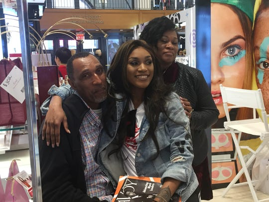 Victoria Vivians with her parents inside Macy's MAC