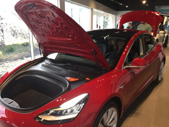 A Tesla 3, powered by electric motors, has storage