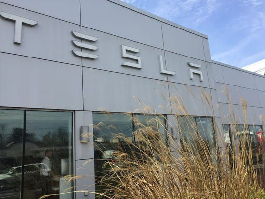 Electric-car maker Tesla opened its first South Jersey showroom Friday on Route 70 in Cherry Hill.